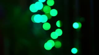 Video of Christmas and new year decoration light. Abstract blurred bokeh green light