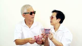 Video of happy rich Asian senior couple. Won lottery or casino cash