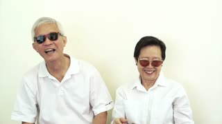 Video of happy rich cool asian senior with lot of cash money. Throwing money in the air