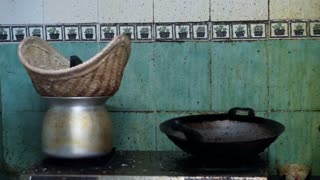 Video of old dirty industrial Chinese kitchen with a lot of oil stain on the wall