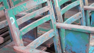Video of old wooden texture blue chair in a row