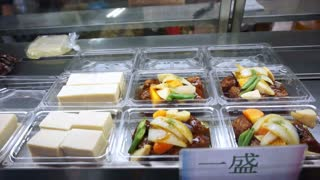 Video of Osaka, Japan -March 2015: Japanese tofu and other side dishes selling at the market