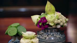 Video of Thai spa accessories setting with candles and herbs