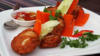 Video of Thai traditional cuisine with fusion decoration. Curry fish cake dish