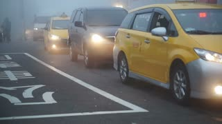 Video of Traffic jam, Yellow taxi cars move slowly in foggy night.