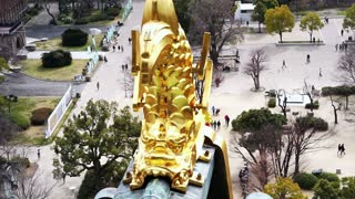Video View from top of Osaka castle. Seeing landmark golden god fish and city scape