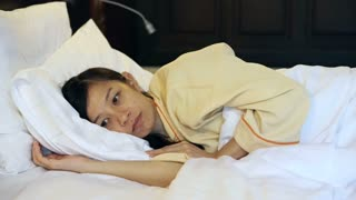 Video worried asian woman in bed, insomnia and thinking about life