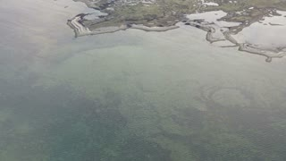 Aerial view of West Europe landscape. Melted snow river runs in to ocean