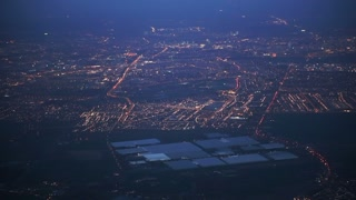 Amsterdam city, Netherlands plane aerial view at twilight night