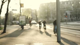 Amsterdam, Netherland royalties free blur sunset evening scene. People biking back home from work. Regular street view of life in the city. Slow motion shot 120fps
