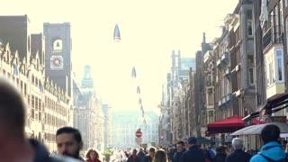 Amsterdam, Netherlands - 4 April 2017 : Diversity tourist walking around main shopping street in Amsterdam