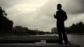 Asian Business Man standing at pier vision concept