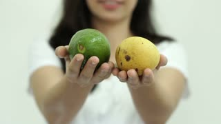 Asian girl hands show fruits, avocado and mango for good health concept