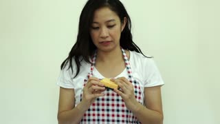 Asian housewife apron and sponge to clean house