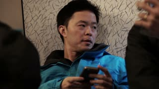 Asian man use smart phone during travel backpack trip in Europe slow motion