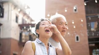 Asian senior couple exciting surprise at new place travel 4k