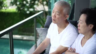 Asian senior couple talk, discuss life problem together