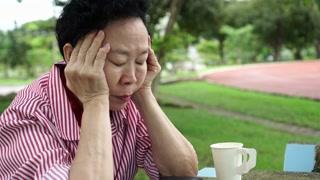 Asian senior elderly has no money stress, financial worry in park