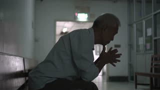 Asian senior elderly man worry about health medication fee at hospital