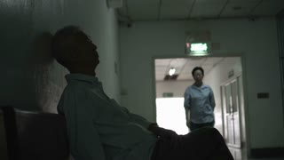 Asian senior parents couple waiting for news from surgery doctor sad, stress and worry 4k