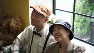 Asian senior vintage dress use internet technology tablet video