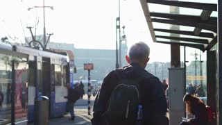 Asian senior with family travel to Amsterdam and using tram for transport around the city slow motion 120fps