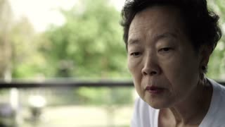 Asian senior woman stress and worry expression 4k