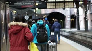 Asian tourists walking at train station in Copenhagen, Europe video
