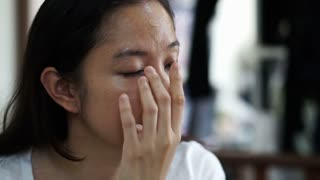 Asian woman apply foundation on her face before doing cosmetic make up in slow motion
