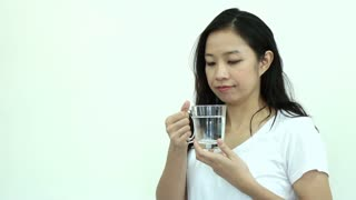 Asian woman drinking water 8 cup a day for healthy skin and body slow motion video