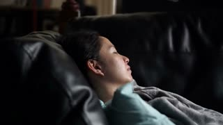 Asian woman sick alone sleeping at sofa with blanket video