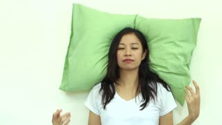 Asian woman sleep concept pillow on wall slow motion video