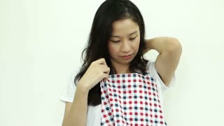 Asian Woman Wearing Apron Ready For Housework
