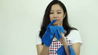 Asian woman wearing cleaning glove