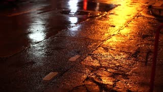 Bad old cracked wet road condition with car traffic light video 4k