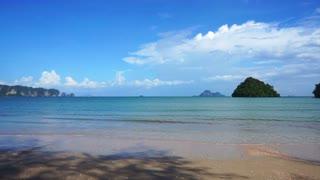 Beach view of Krabi, Thailand. Tropical paradise scene of blue ocean, mountain and sky
