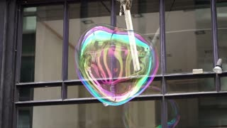 Big soap bubble being made and floating in the air then explode in slow motion 120 fps