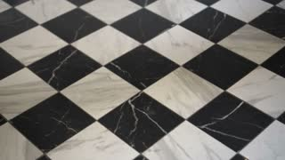 Black and white European marble stone checker pattern floor interior 4K
