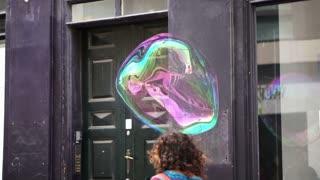 Bubble 1 Artist Editorial: Copenhagen, Denmark: April 2017 - Street artist creating big soap bubble in downtown area for entertaining pedestrian
