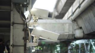 City cctv surveillance over street, people and public traffic video 4k