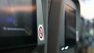 Close up of no smoking sticker sign on airplane seat