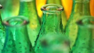Colorful glass bottles and vases. Close up abstract vivid rainbow color material