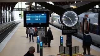 Copenhagen, Denmark - 13 April 2017 - Copenhagen train station board and clock slow motion video
