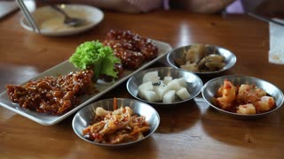 Eating Korean spicy sauce fried chicken with side dishes 4k