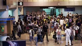 Editorial: Bangkok, Thailand: July 2015: Don Meung Airport, tourist crowded at luggage picking belt. Busy airport during holiday season