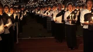 Editorial: Chiangmai, Thailand - 5 December 2016: Respect condolences candle dance in memory for King Bhumibol Rama iX of Thailand