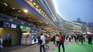 Editorial: Hong Kong - April 2016: Hong Kong, Legal gambling in Happy Valley horse racecourse game, jockey club at night.
