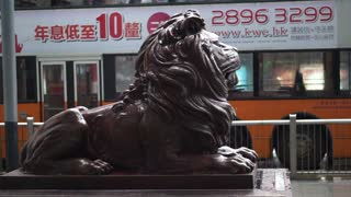 Editorial: Hong Kong - April 2016: Lion statue at the entrance of HSBC Bank head quarter Tower in Central District, Hong Kong.