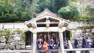 Editorial: Kyoto, Japan - March 2015: people praying at spirit waterfall of ancient Kiyomizu-dera (Kiyomizu Temple) in Kyoto, Japan.