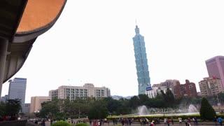 Editorial: TAIPEI, TAIWAN - February 2016 : Taipei 101 landmark building view from Sun Yat-sen Memorial with fountain show and tourist